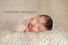 newborn baby in taco pose