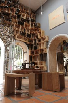 Alejandro Preciado hired Pop+Dots to cover his art gallery completely using reclaimed wood pieces.