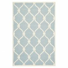Soften your bedroom or living room scheme with this hand-tufted rug, showcasing a trellis motif in blue tones. Team with pastel decor and bare wood finishes for a sense of contemporary elegance.  Product: RugConstruction Material: 100% Wool pileColour: Blue and ivoryFeatures: Hand-tuftedPile height: 1.6 cm Note: Please be aware that actual colours may vary from those shown on your screen. Accent rugs may also not show the entire pattern that the corresponding area rugs have.Cleaning and ...