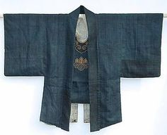 Daimyo hikeshi shozoku: Samurai fire-fighter's wool jacket with a Kiri-no-mon crest couched with gold leaf threads (wrapped around silk thread), chest protector baring the same crest. Late Edo period (1603-1868)