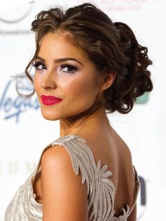 Fun, youthful and pretty makeup paired with a fancy curled updo. Colorful, sparkily eyeshadow and pink-red lips. #missuniverse