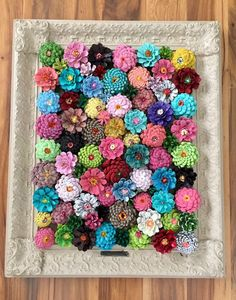 "When I saw this wall art, it struck me because of it's bold color and beautiful layout. Then I looked closer and realized that these gorgeous ""flowers"" are actually made from something very familiar. Can you guess what they are? Here is a closer look: source PINE CONES! Check out crafty morning to find out how …"