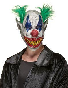 Clownsmaske aus Latex mit scheußlicher Fratze: Diese Clownsmaskefür Erwachsene besteht aus elastischem Latex.Es wird ein fies grinsender Clown mit einer roten Nase  und mit grünen, an der Seite der Maske befindlichen, Haaren dargestellt. Die...