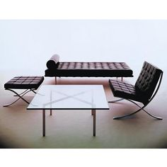 Mies van der Rohe, black leather Barcelona chair, ottoman, daybed, & table