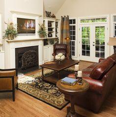 Nice fireplace, hardwood floor with area rug