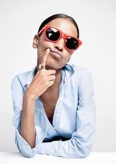 Liya Kebede // red sunglasses, chunky gold ring and classic blue button-down shirt Red Sunglasses, Sunnies, Provocateur, Poses, Blouse, J Crew, Glamour, Stylish, La Perla