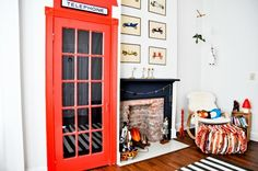 Awesome Kids room! Love the fake fireplace and British theme