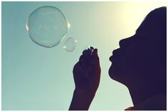 Teaching a small child to blow bubbles (a few of my favorite things)