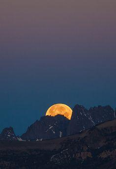 full moon rising over the mountain looks like italy.