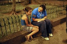 An outreach worker speaks with an 11-year-old girl whom she found on the streetat night in Medellín, Columbia. The outreach team includes members from the UNICEF-assisted 'School Going to the Child' programme. They hope to identify children who live or work on the streets or who are being abused or sexually exploited, and persuade them to go to shelters where they can receive food and social services and begin the process of returning to school. © UNICEF/Susan Markisz http://www.unicef.org