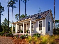 Designer Lisa Furey designed this low-country cottage to exude farmhouse charm through board-and-batten siding, simple landscaping and bucolic decor.