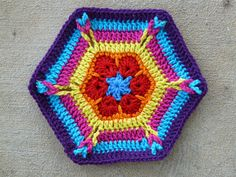 Variation on an African flower hexagon: 8 rounds
