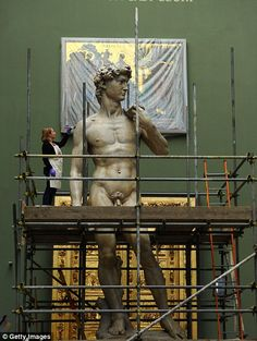 The Victoria and Albert Museum's sculpture conservator Johanna Puisto works on giant plaster cast of statue of David