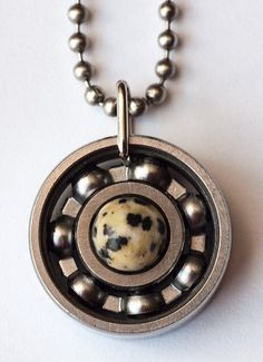 Let your inner child come out to play with this adorable piece! The Dalmatian Stone appeals to the child within us all, fortifying the spirit and encouraging a sense of playfulness. And, I mean, who doesn't love dalmatians? #derbygirldesign #bearingjewelry #jewelrythatrocks #dalmatianstone #dalmatianjasper #innerchild #puppylove #comeplay