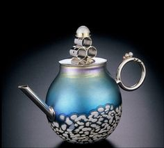 I love the turquoise color as well as the handle and well I guess I like every thing about this teapot