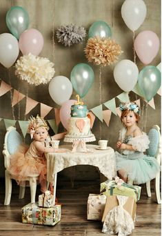 Dusty pastels party table. Tea party or birthday party? The balloons and giant tissue paper flowers are adorable!
