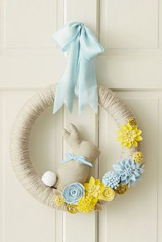 Easy instructions and free printable Hallmark templates to make this beautiful, yarn-wrapped wreath with felt flower attachments. Add the optional bunny to get a hop on your Easter decorating!