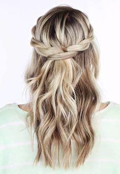 Halo-type braids pair perfectly with loose waves. This twisted crown braid by Twist Me Pretty takes minutes to re-create and looks great on long or medium-length hair.