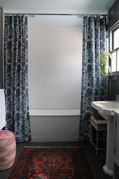 Decor Tip:: Hang Double shower curtains at the ceiling for a more dramatic effect