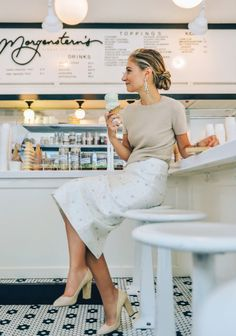Love these neutrals on Jenny Walton. A ladylike pencil skirt feels modern in a luxe, neutral color palette with a slicked-back hairstyle.
