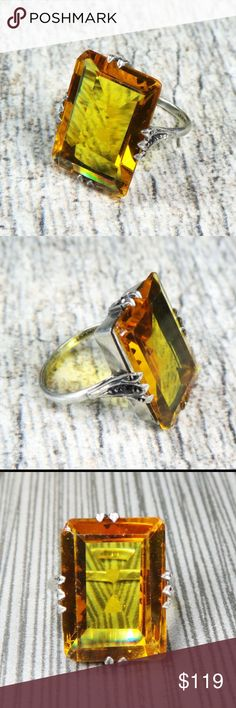 Vtg Art Deco Yellow Citrine Statement Ring Striking vintage art deco sterling silver citrine ring with wonderful color. The large citrine is slightly chipped at one corner but this is hardly noticeable, in my opinion. An interesting feature is that the prongs are at the center of the stone rather than at the corners; on sides is a small faceted onyx stone. Faintly marked Germany on the inside. Unmarked but tests for sterling silver.  Some signs of wear consistent with its age but in lovely…