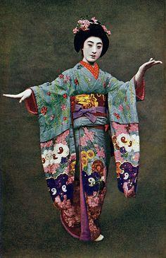 Geiko Tomigiku dressed for the Miyako Odori 1920s. Tomigiku in a dancing pose for the Miyako Odori (Cherry Dance) in Kyoto.