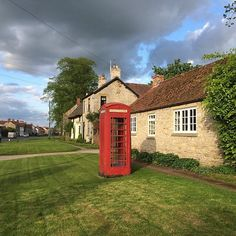 The red telephone box is quintessentially British. What reminds you of #Britain? Photo taken in #Yorkshire, by @mamanvoyage #LoveGreatBritain