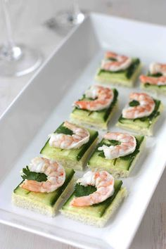 Shrimp, Cucumber & Curry Cream Cheese Canapes With Unsalted Butter, Cream Cheese, Curry Powder, Kosher Salt, Canola Oil, Large Shrimp, Kosher Salt, White Sandwich Bread, English Cucumber, Fresh Cilantro