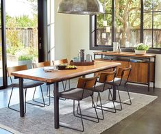 Complete your rustic industrial dining room with the Karsten dining chair. Sleek black metal shapes the connected base. Wood backrest and cushioned seat. Modern Rustic Dining Table, Narrow Dining Tables, Scandinavian Dining Table, Simple Dining Table, Reclaimed Wood Dining Table, Dining Table Chairs, Dining Furniture, Contemporary Dining Table, Industrial Dining Tables