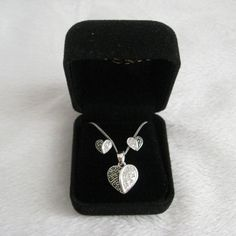 Genevieve & Grace Marcasite Heart Jewelry Set Genevieve & Grace Marcasite Heart Jewelry Set in Sterling Silver $135 MSRP. New. Never worn.  Features: • Heart pendant necklace and coordinating stud earrings bedecked with glimmering marcasite.  • Crafted in sterling silver.  • Approximate length: 18 inches.  • Approximate drop: 11/16 inch.  • Approximate diameter: 1/4 inch TRADESWAP ✔️15% OFF on Bundles. Reasonable offers are welcome. All sales are final. Thanks for looking! Genevieve & Grace…
