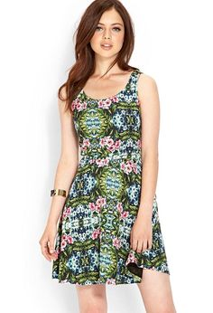 Love 21 - A tropical print woven dress featuring a V-back and self-tie sash. . Concealed back zipp...
