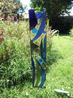 Stained glass garden art from Feral Glass