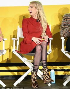 Fancy footwear:She turned even more heads with her choice of footwear; a pair of daring z...
