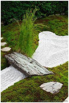 small raked gravel area with stone bridge  daitoku-ji, japan