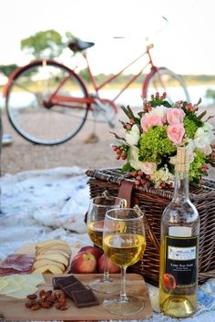 For a more sophisticated picnic opt for wine a basket filled with delicious cheeses, nuts, cured meats and chocolate. Photo by Eureka Photography. #weddingpicnic #picnicbasket #summerwedding