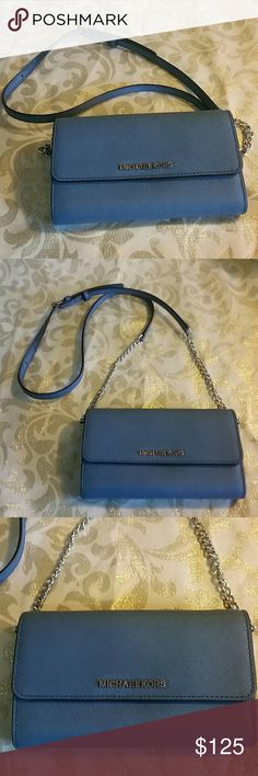 Michael Kors crossbody / wallet / clutch Michael Kors crossbody / wallet / clutch. Beautiful blue color 'denim'. Strap is button snaps and detachable to turn into wallet or clutch. Matches MK bag in my closet. Bundle for savings. Ink stains on outside compartments shown in last pic. Michael Kors Bags