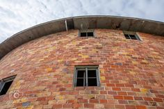 Plagmann Round Barn, Marengo, Iowa // 85' diameter, 3 story barn built in 1912 of clay tile considered the largest round barn in Iowa. The first story was for cattle, second story had 30 horse stalls, and the 110,000 cubic ft 3rd story loft held 200 tons of hay. central silo is 20' diameter and 45' tall (60 feet to top of barn). Second Story, First Story, Clay Tiles, Horse Stalls, Cattle, Iowa, Gado Gado, Stables