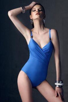 Swimsuit crafted in spandex and nylon, featuring double slim straps, wholecolored design, shirred to side, soft-handle cups.