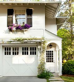 If you have a street-facing garage, updating it to match your home's style is a sure way to boost appeal. X-motifs and windows seamlessly integrate with this charming exterior.  Not ready to splurge on a new door? A fresh coat of paint or an above-the-garage pergola are also noteworthy upgrades.
