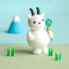 this artist makes these itty bitty clay figures...this one is just too adorable!