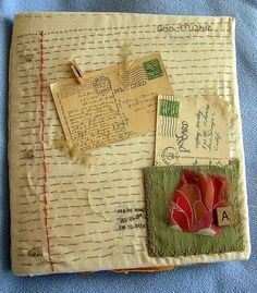 hand stitched scrapbook cover.