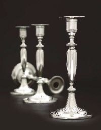 A SET OF FOUR AUSTRIAN SILVER CANDLESTICKS, MARK OF JOHANN SEBASTIAN WÜRTH, VIENNA, 1799, FROM THE COLLECTION OF H.R.H. THE PRINCE HENRY, DUKE OF GLOUCESTER KG, KT, KP.