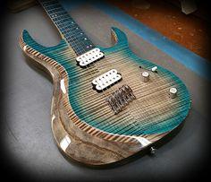 "Kiesel Guitars Carvin Guitars  AM6 (New Aries Multiscale, 24fret bolt on neck Guitar) in a custom color Aqua cali burst with deep body binding effect , Kiesel Treated board ""Aqua"""