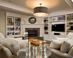 corner fireplace design with built in entertainment center and bookcase (houzz- Witt Construction), now that's how I like a fireplace and tv in one room, no straining your neck to look up at the tv over the fireplace