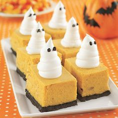 Pumpkin cheesecake bars with whipped cream ghosts--perfect for Halloween parties