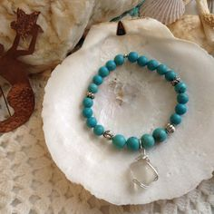 Turquoise bead stretch bracelet w/ SeaGlass charm from WaterSpiritsJewelry on Square Market.