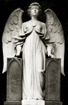 Highgate Cemetery Angel by Mark Coggins, via Flickr