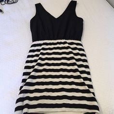 Black and white dress ! Small pocket on front Black sheer top with cotton white and black stripped bottom. Front and back identical minus black pocket on front . Size small . Above knee length . Forever 21 Dresses