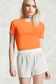 A sheer mesh knit crop top featuring a crew neck and short sleeves.