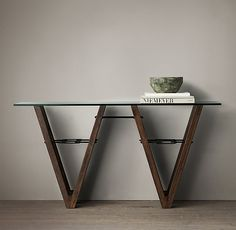 No longer available. A console with a wonderful shape and an industrial edge. This is the Reclaimed Wood & Glass V-Form Console Table, designed by Thomas Bina. At Restoration Hardware.